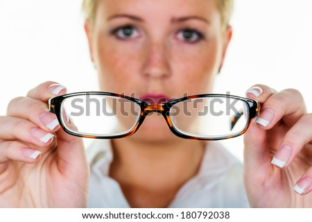 a woman holding glasses