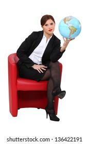 A woman holding a globe.