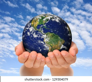 Woman holding globe on her hands, South and North America. Elements of this image furnished by NASA
