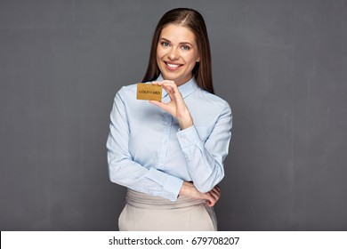 Woman holding gold credit card. Smile with teeth.