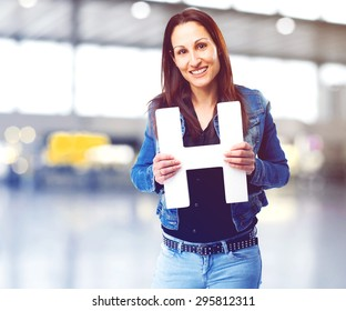 woman holding the H letter