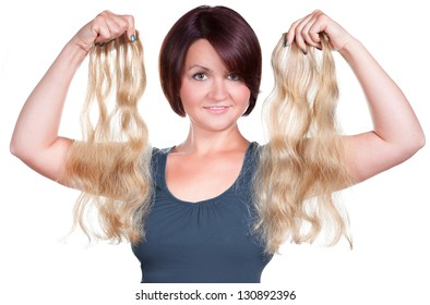 Woman holding hair extensions