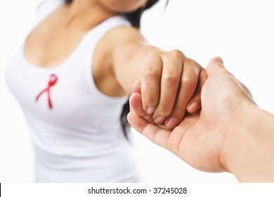Woman holding hand to give support for AIDS cause or breast cancer,with red ribbon on her chest. PS:you can change the ribbon color to pink for breast cancer support cause as both using same symbol