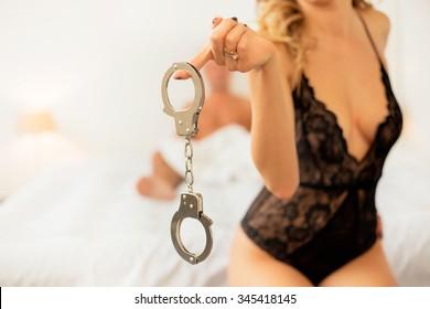 Woman holding handcuffs
