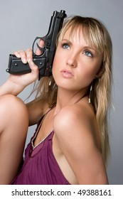 Woman Holding Handgun