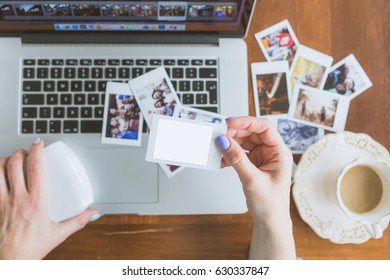 Woman Holding In Hands Instant Photo Frame with place for photo of Your choice