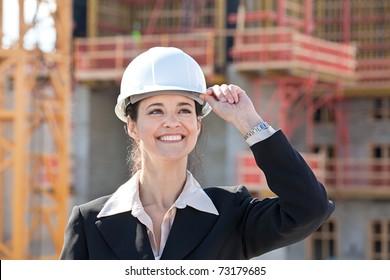 Woman holding hard hat