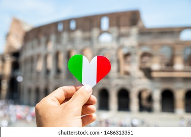 Woman Holding Heart Shaped Italian Flag In Front Of Colosseum, Italy