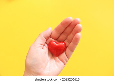 Woman holding heart symbol of love