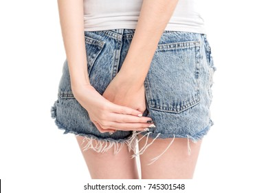 Woman holding her bum and pain in the butt isolated on white background