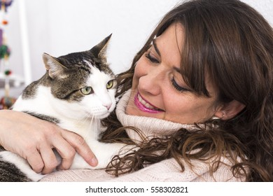 Woman holding her cat. Close up