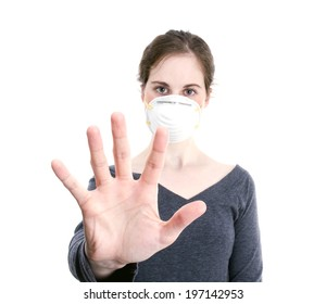 A woman holding her hand out with a face mask on.