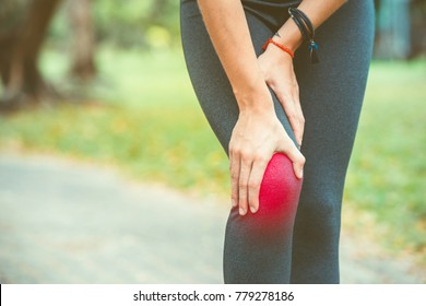 Woman holding her knee with red painful during a workout session sport. Pain relief concept