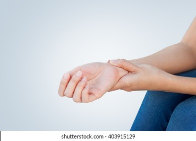 Woman holding her wrist, pain concept, Office Syndrome.