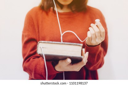 ?Blurred of Woman holding the holy bible and headphones,Concept listen the words of God