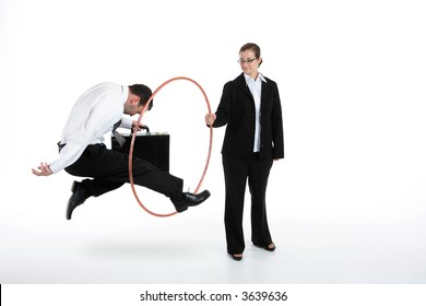 Woman holding hoop with businessman jumping through
