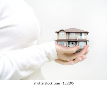 Woman holding house. Its not a model, it