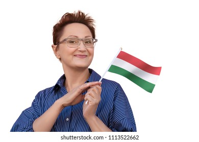 Woman holding Hungary flag. Nice portrait of middle aged lady 40 50 years old with a national Hungarian flag of isolated on white background.Learning Hungarian language. Visit Hungary concept.