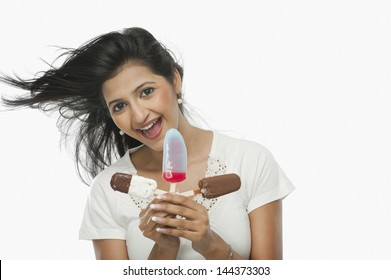 Woman holding ice creams and laughing