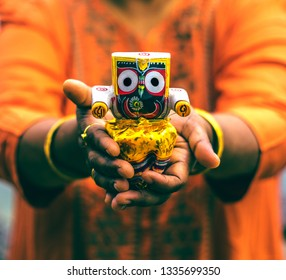 Woman holding an idol of Lord Jagannath