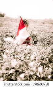 Woman Holding Indonesian Flag at The Tea Plantation