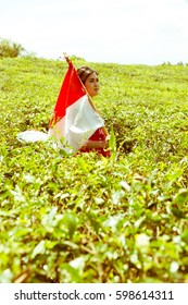 Woman Holding Indonesian Flag at The Tea Plantation (colourfull)