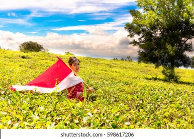 Woman Holding Indonesian Flag at The Tea Plantation (Landscape)