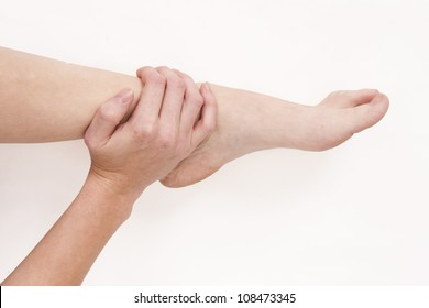 Woman holding injured ankle
