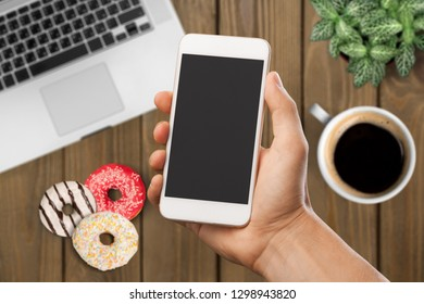Woman holding iPhone X with Internet shopping service Aliexpress on the screen. iPhone 10 was created and developed by the Apple inc.          - Image