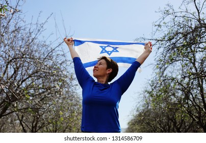 Woman holding an Israeli flag