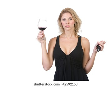 Woman holding keys to car while also holding a wine glass.