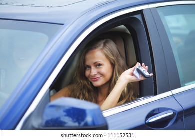woman holding keys from new car