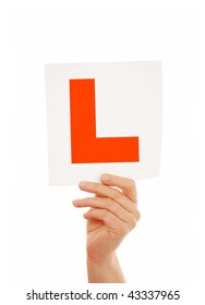Woman holding L plate sign over white isolated background