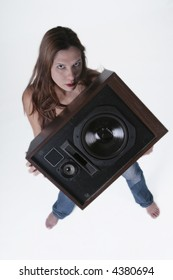 woman holding a large speaker