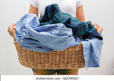woman holding a laundry basket full of clothes