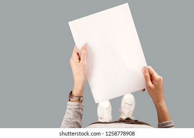 woman holding letter pages