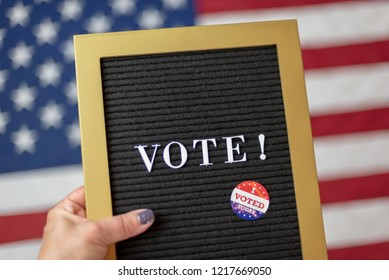 Woman holding letterboard sign with the word Vote