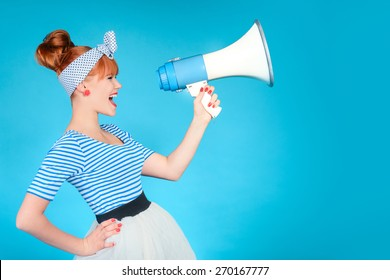 Woman holding a megaphone on blue background