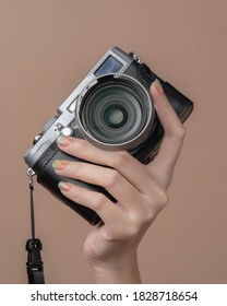 woman holding mirrorless camera beautiful finger nails manicure after spa ready for skincare travel self portrait photoshoot for vlogging and blogging business