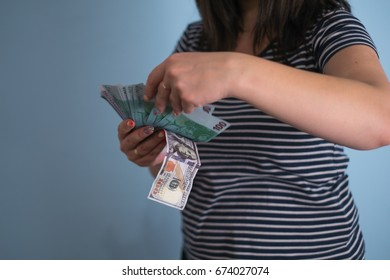 woman is holding money