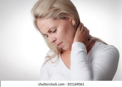 woman holding the neck. sore throat, meningitis