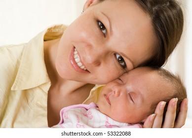 woman holding  a newborn