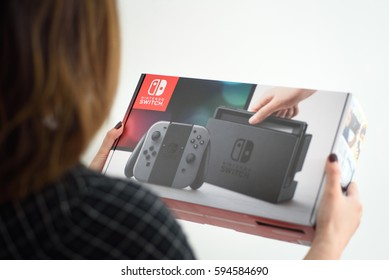 A woman holding a newly purchased Nintendo Switch console in Yonkers, New York on March 5, 2017.
