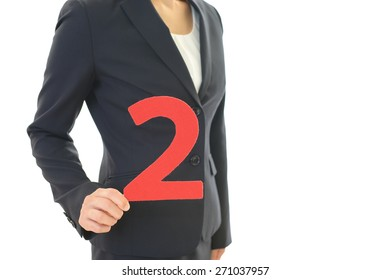 Woman holding number 2