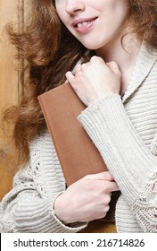 Woman holding old book