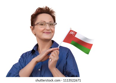 Woman holding Oman flag. Nice portrait of middle aged lady 40 50 years old with a national flag of Oman isolated on white background.Visit Oman concept
