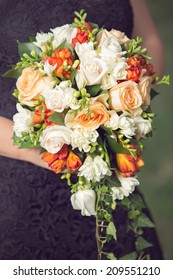 woman holding on to a beautiful cascade flower bouquet
