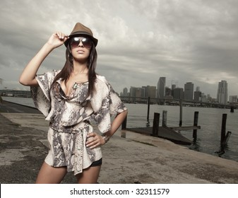 Woman holding on to her hat
