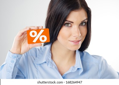 woman holding a orange card