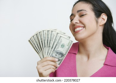 Woman holding out fan of money